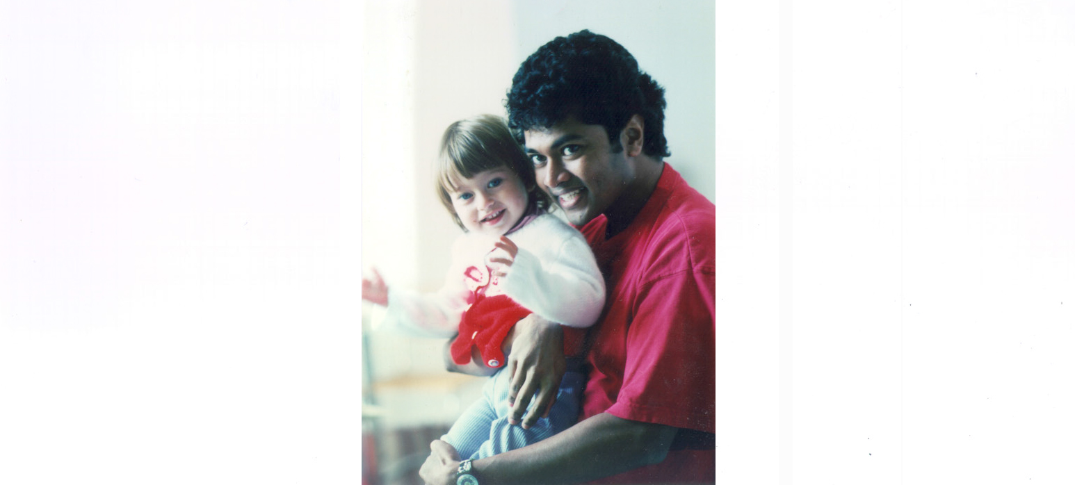 Partha Mitra holding a young Zoe Kleinfeld